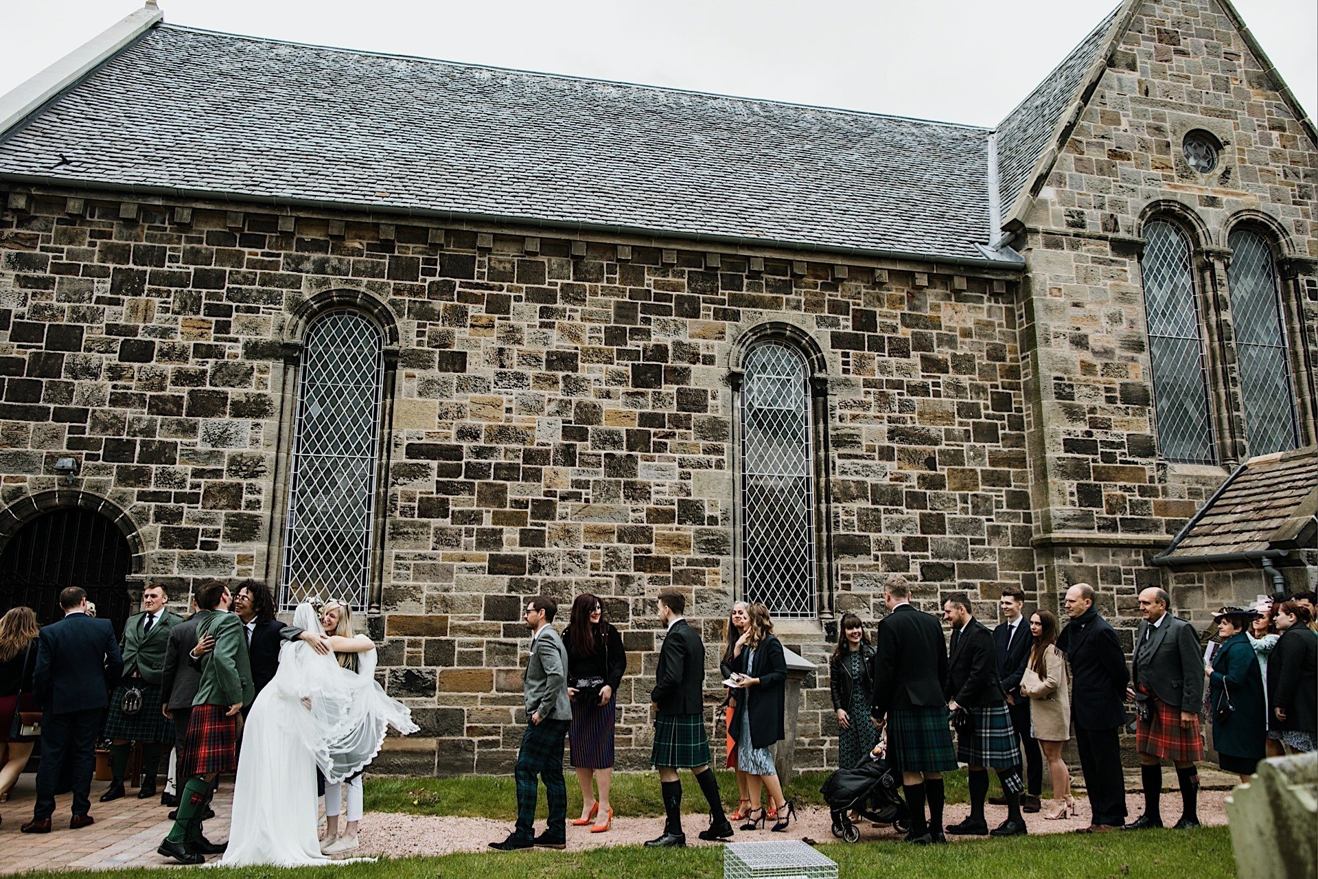 guests of and church couple greeting view exiting married