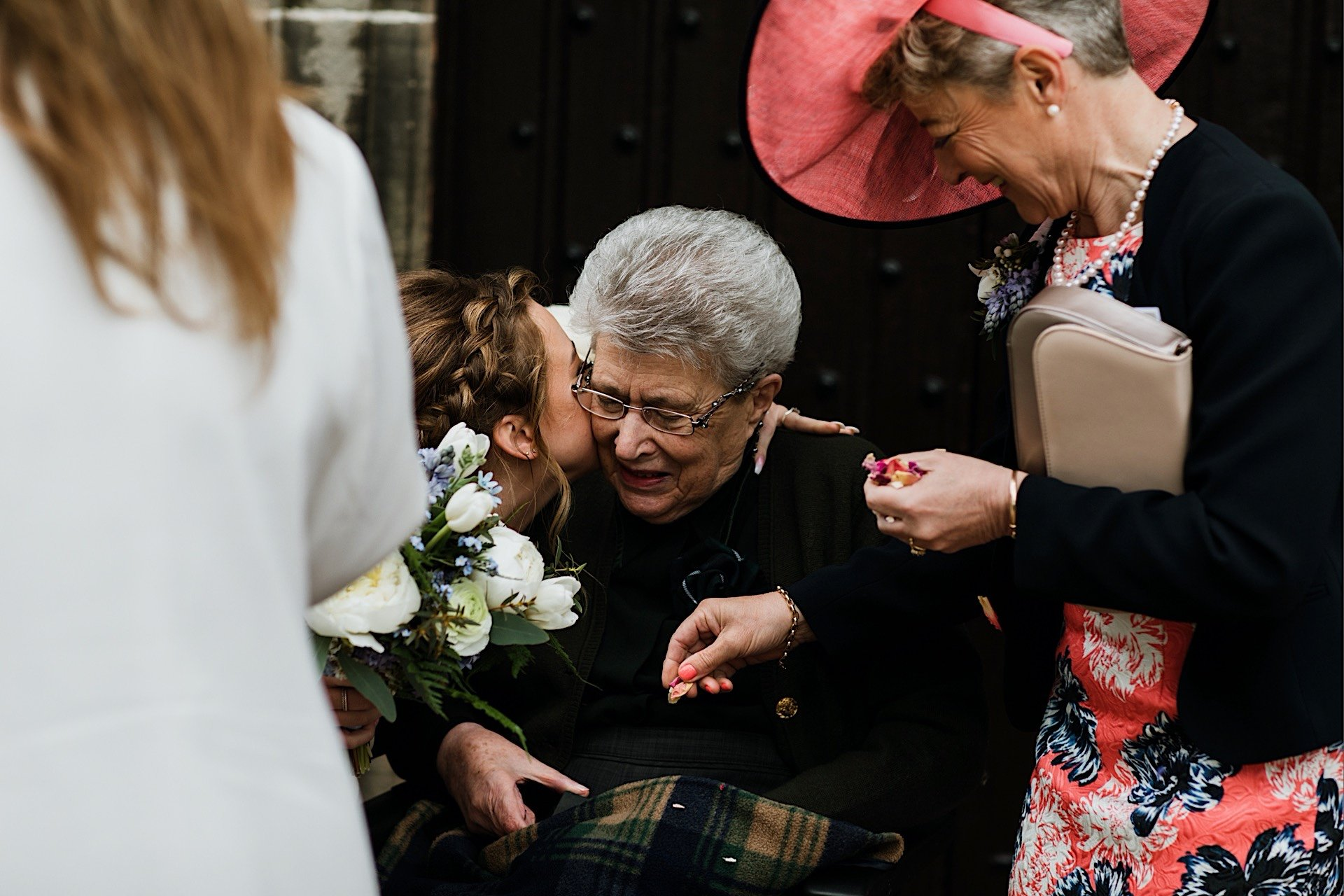 outside by church kissed being grandparent bridesmaid