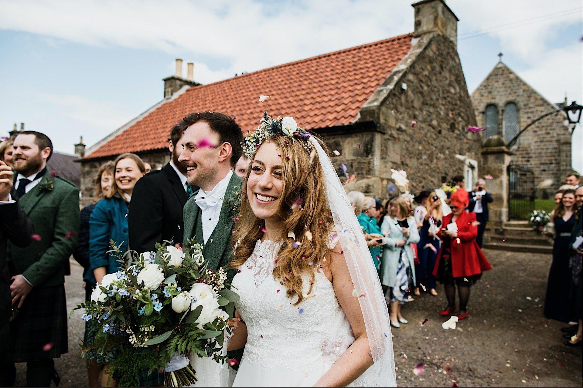 smiling bride as falls confetti