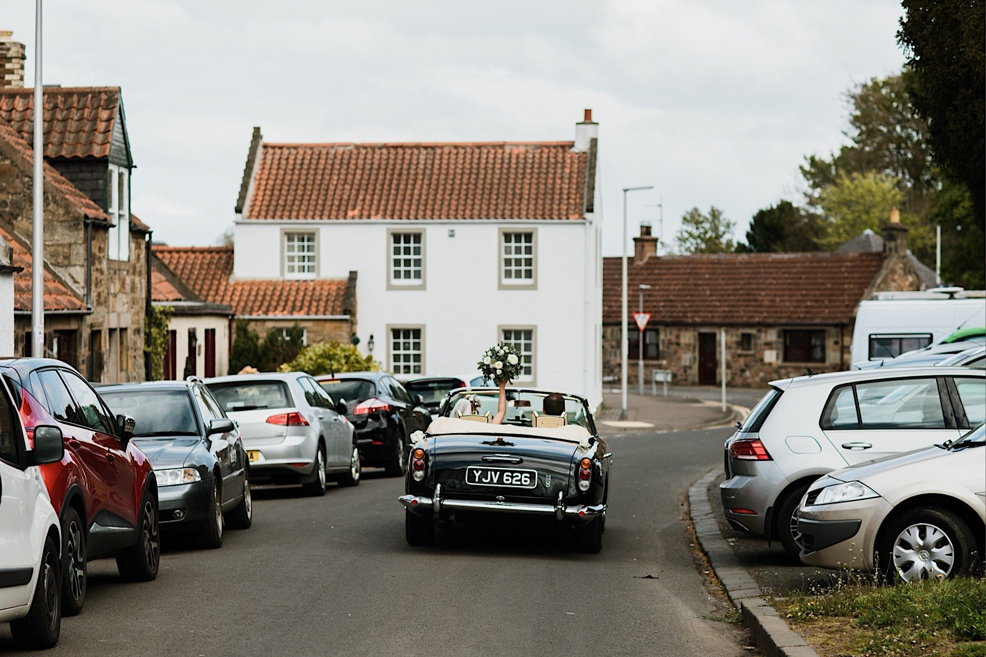 bride aston vintage in dB5 from car away martin and Wedding groom driving church