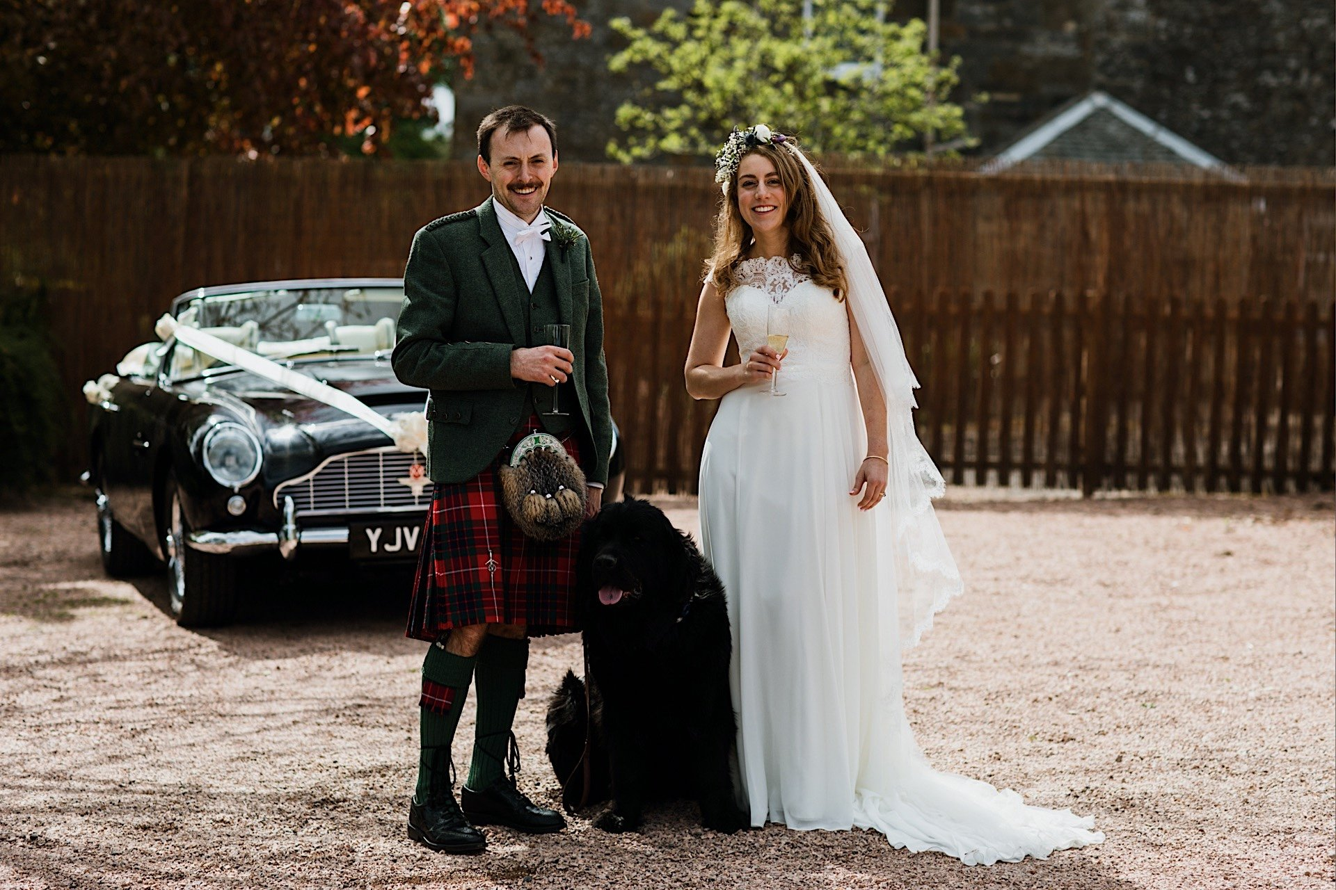 bride aston Rhynd in dog dB5 martin car With background the and their Wedding groom outside