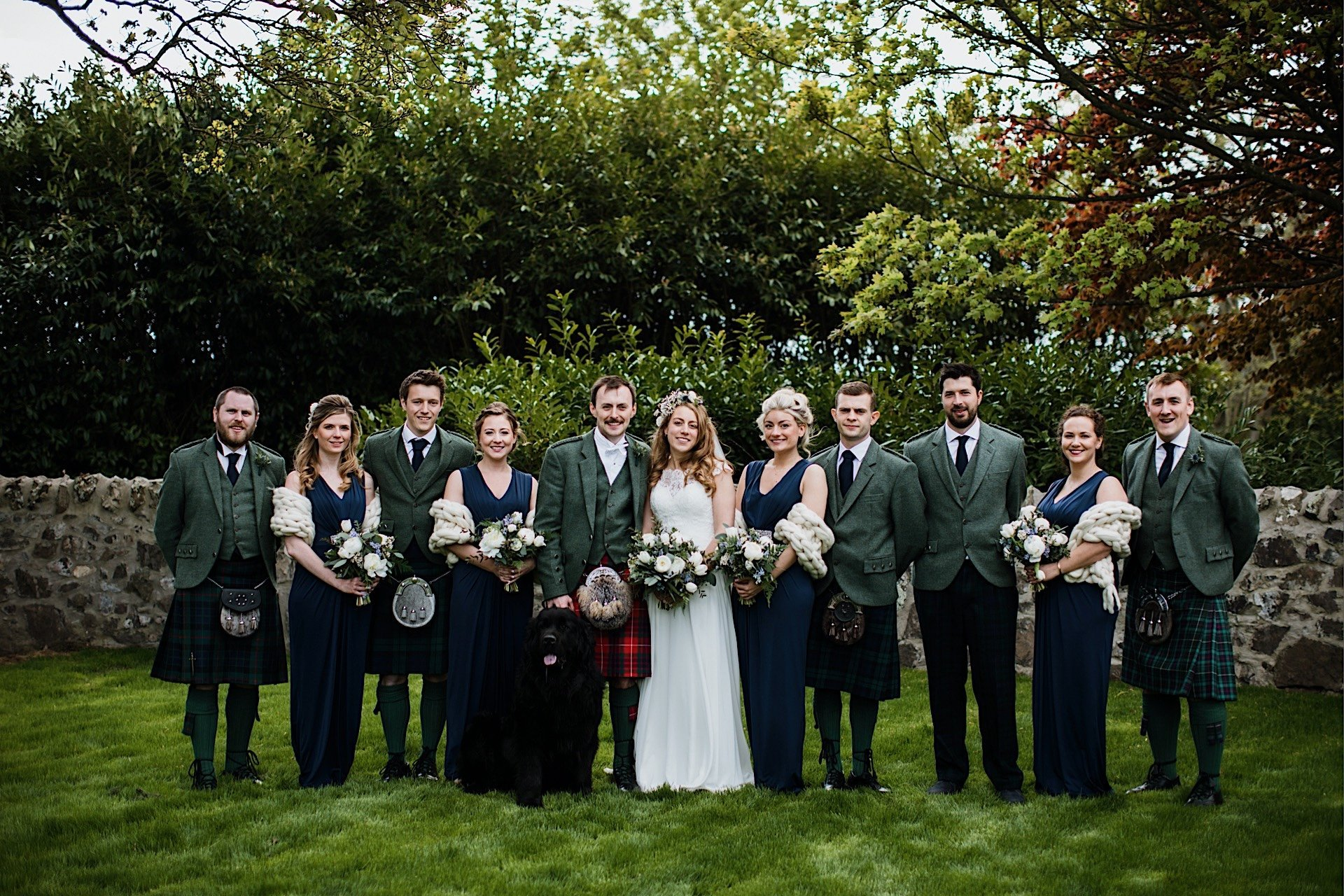 bridesmaids Rhynd garden in party With at group of the and Wedding groomsmen photo