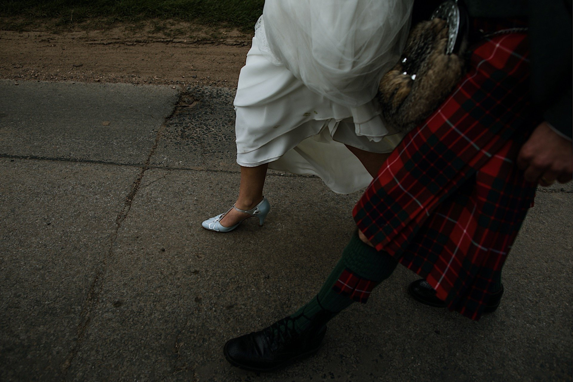bride taken showing dress looking grooms blue shoes image down brides and Red Walking groom kilt