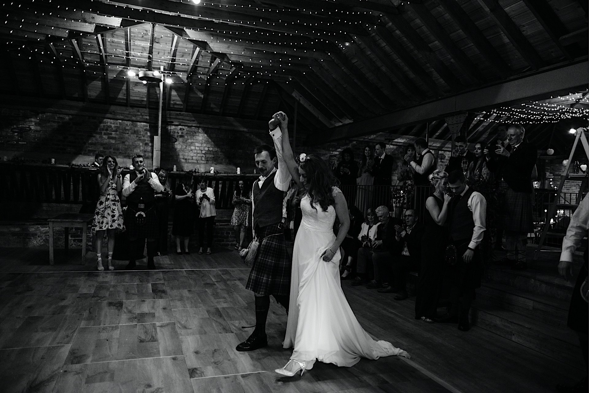 bride Rhynd in appearing arms on With air at dancefloor the and together groom