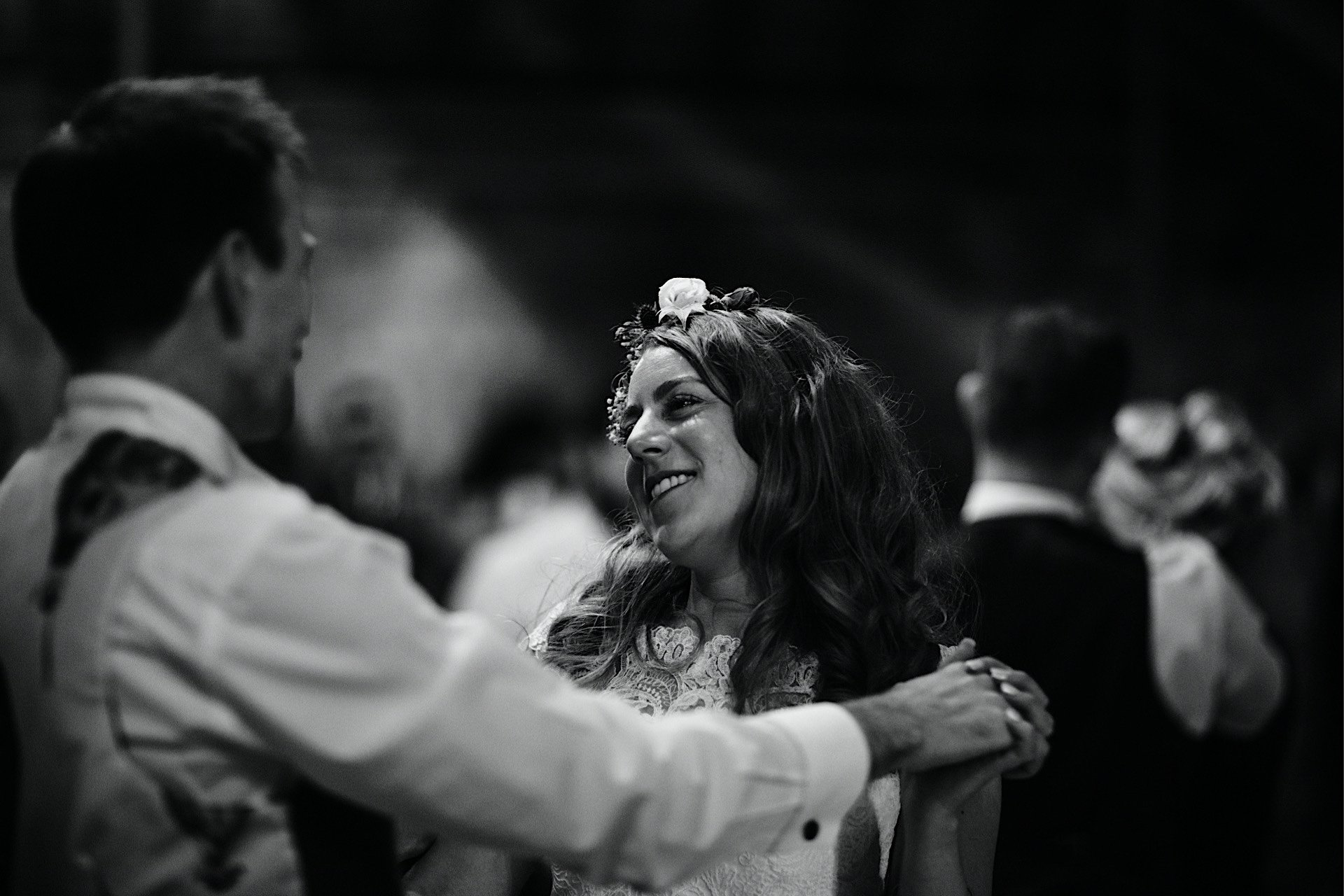 during bride lovingly dance at looking groom first