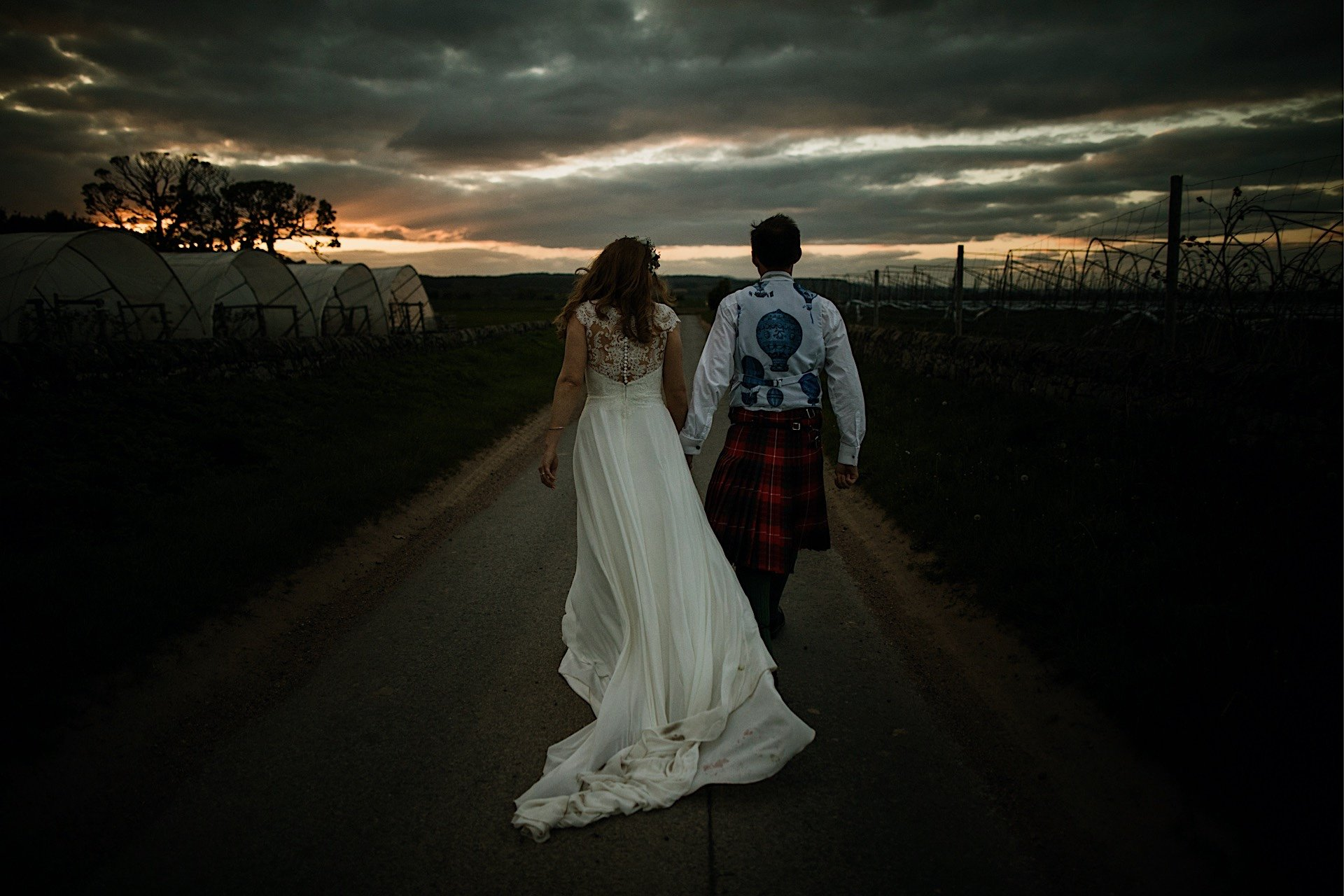 bride Wind in sunset at blowing down the Road and brides Walking groom dress