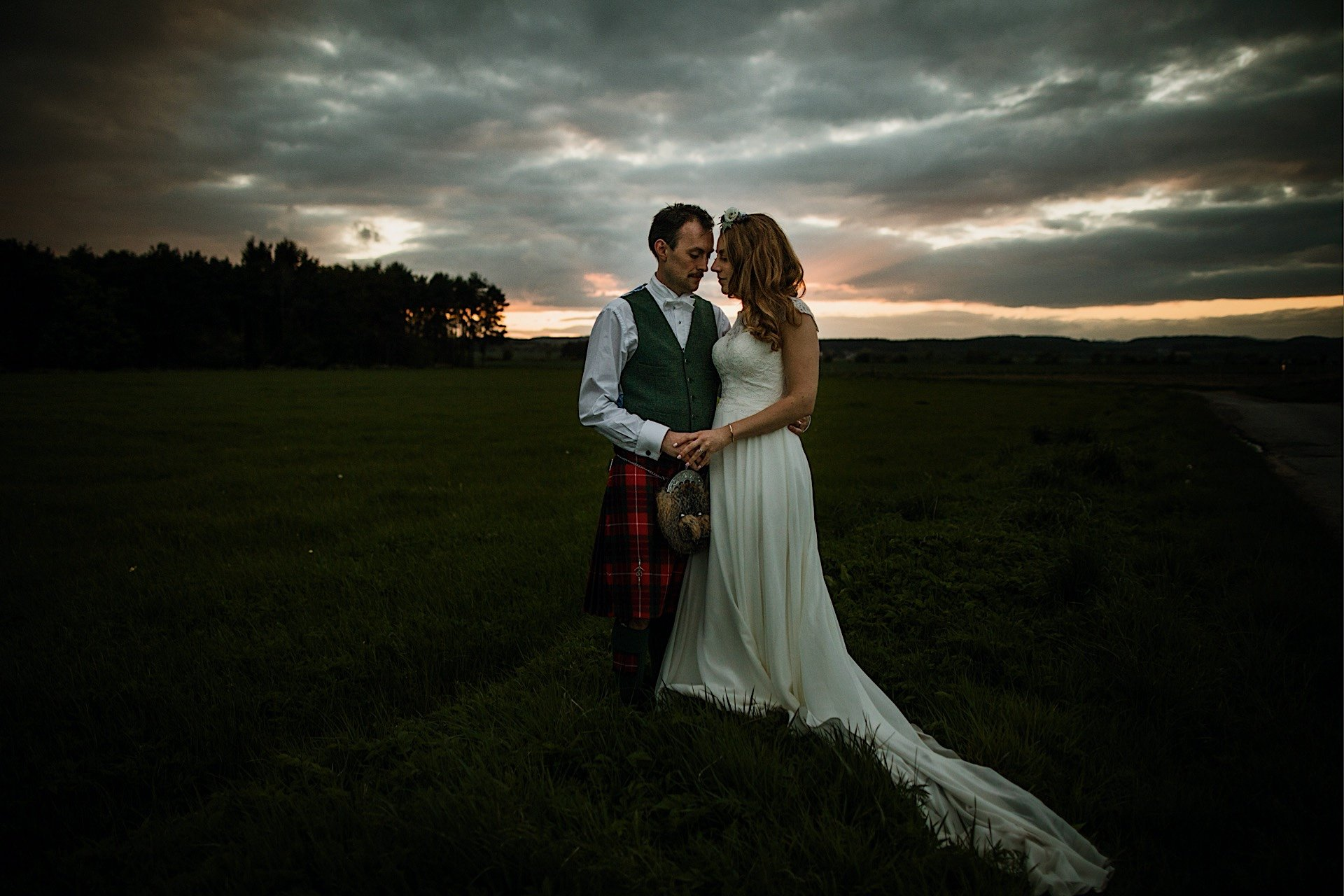 posing portrait bride in and sunset Rhynd field the at groom for