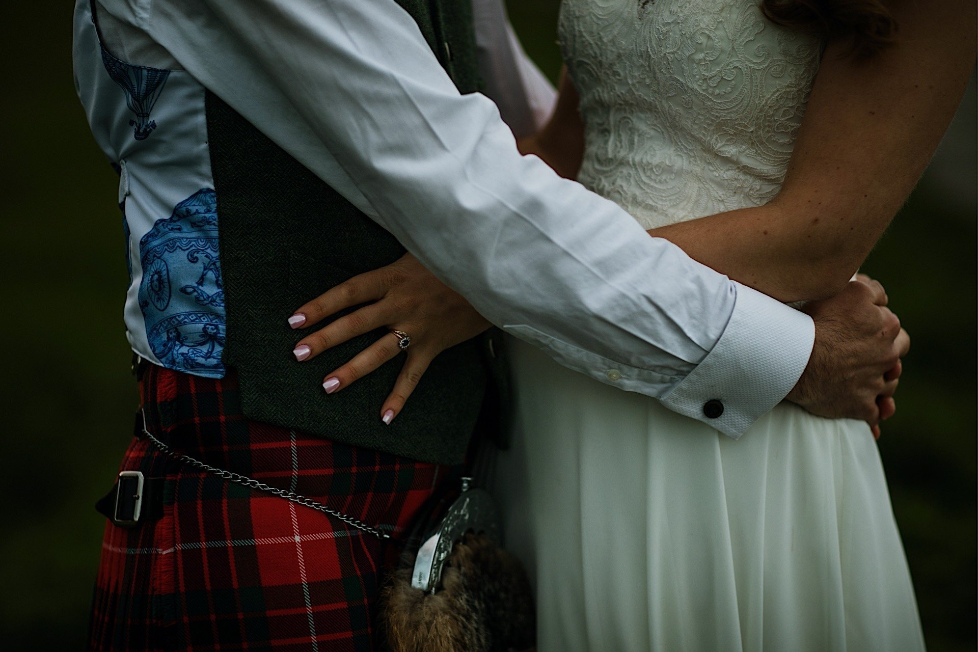 of bride and eachother holding Round Waist closeup the groom
