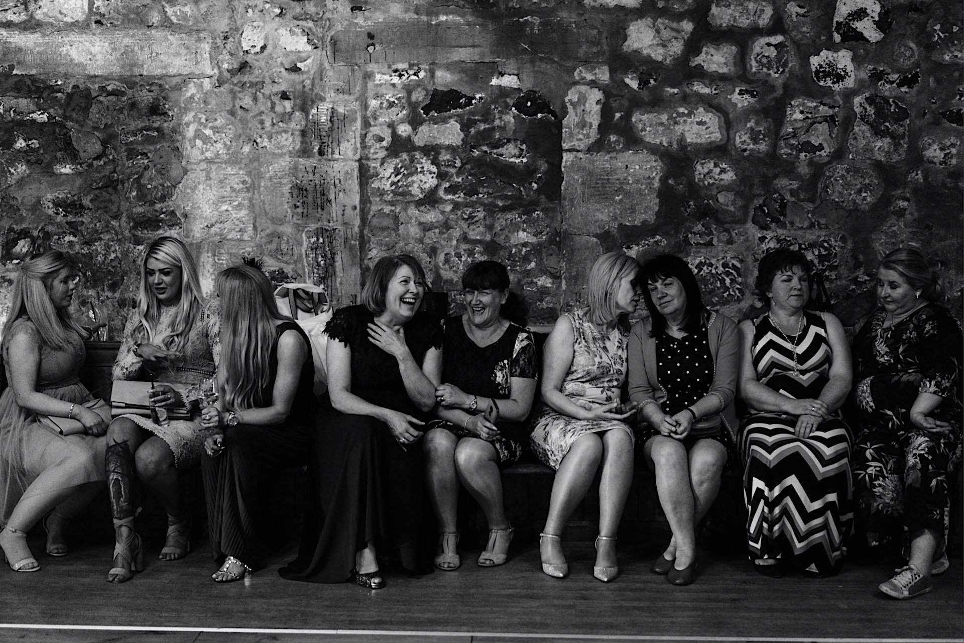 dancefloor sat chatting guests on Wedding