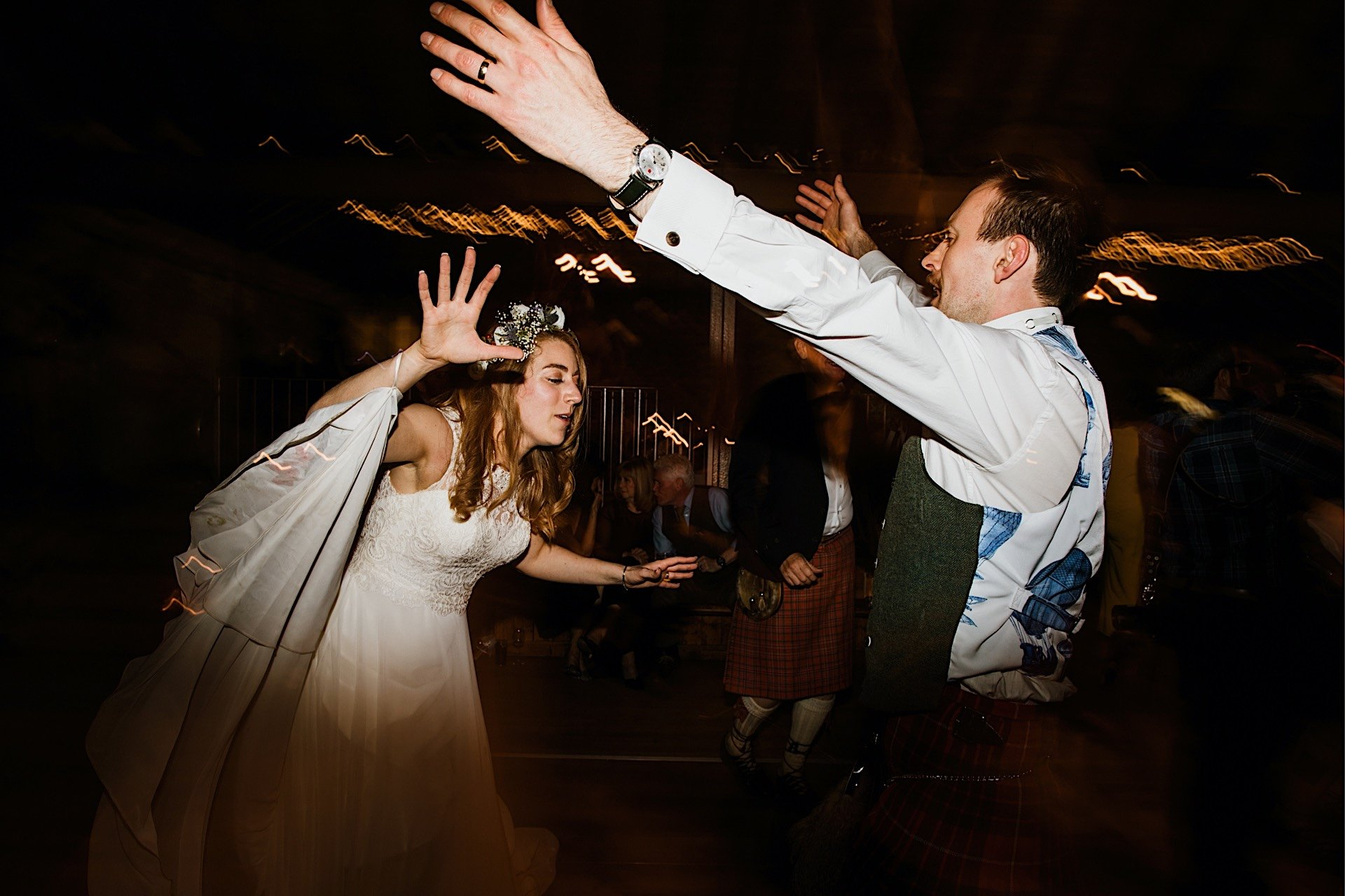 bride dancing groom and