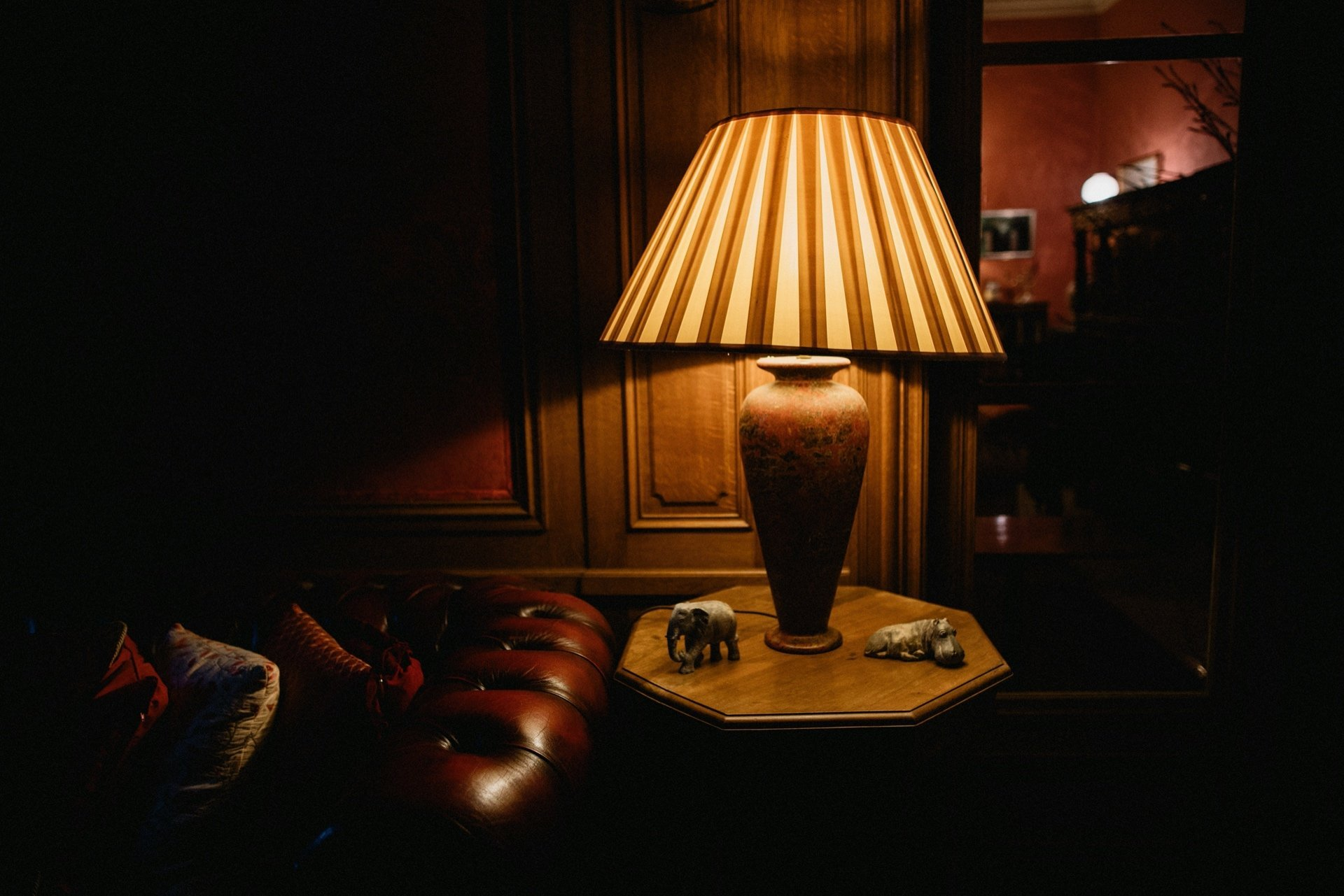 lit lamp in the dark interior at craigengillan mansion house