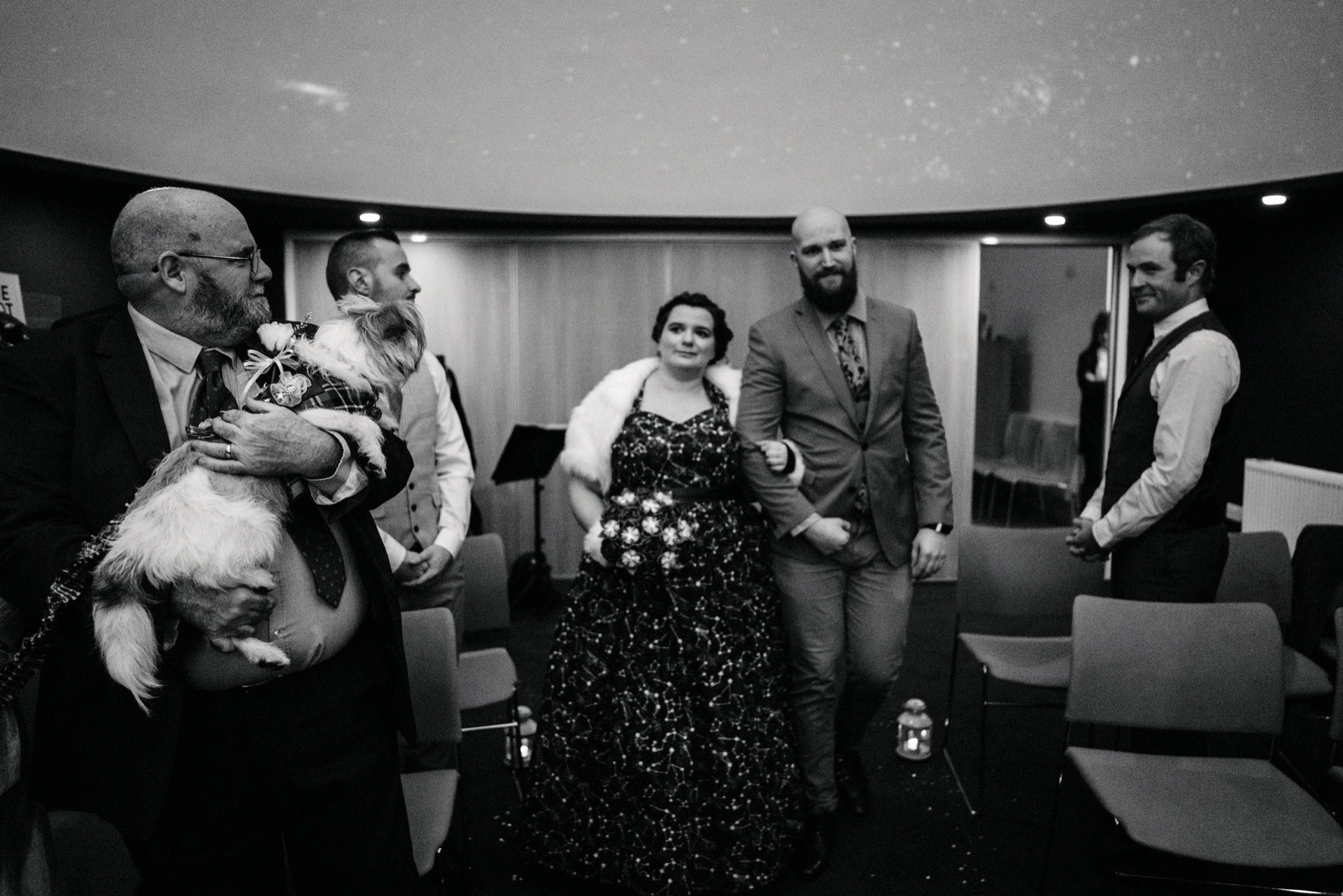 bride makes her entrance to her celestial ceremony in the planetarium at the scottish dark sky observatory
