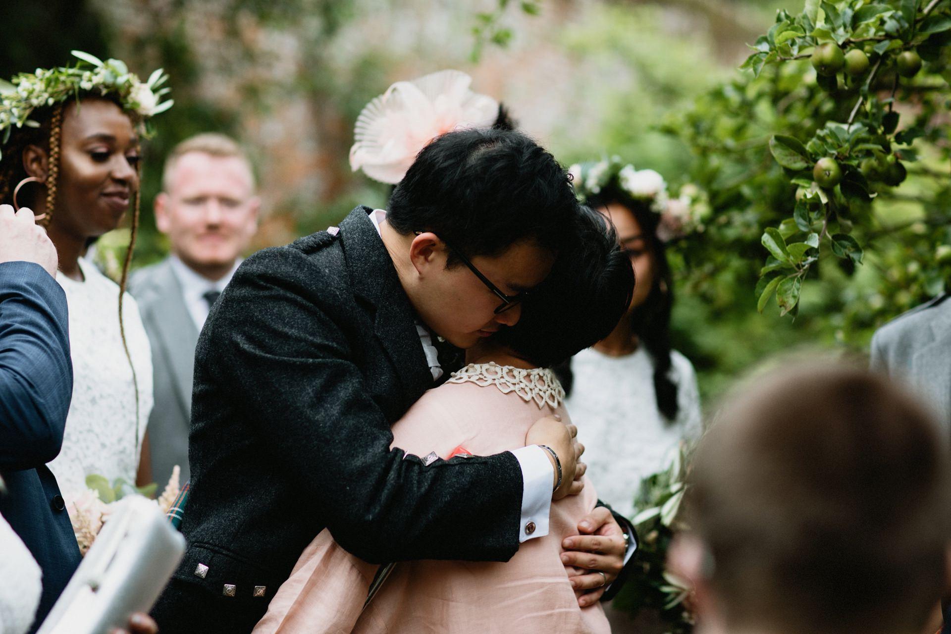 groom hugs mother