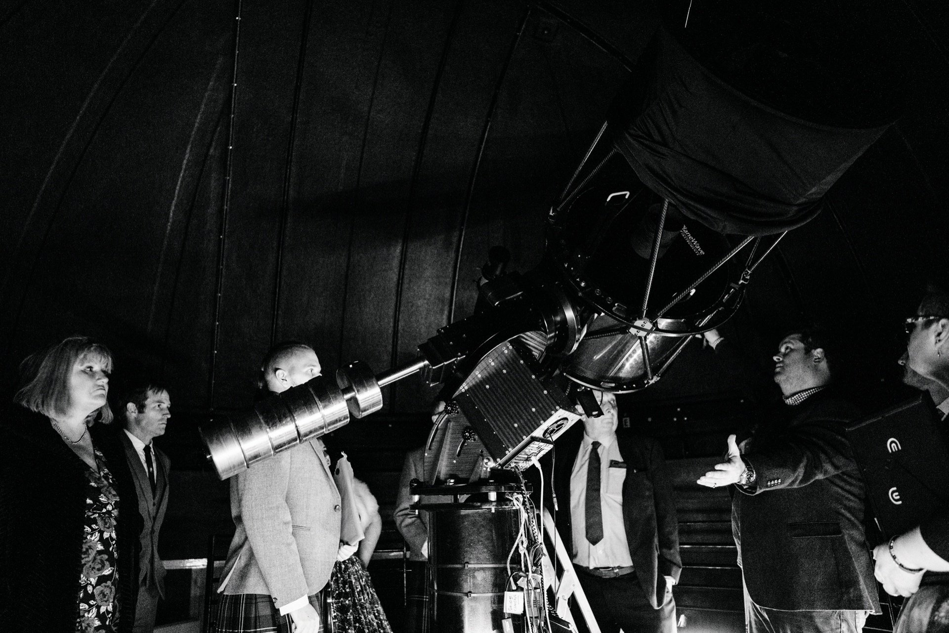 telescope a the dark sky observatory guests watching astronomer