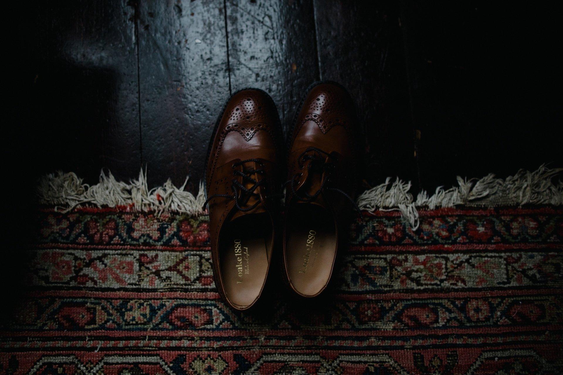 grooms shoes on vintage carpet