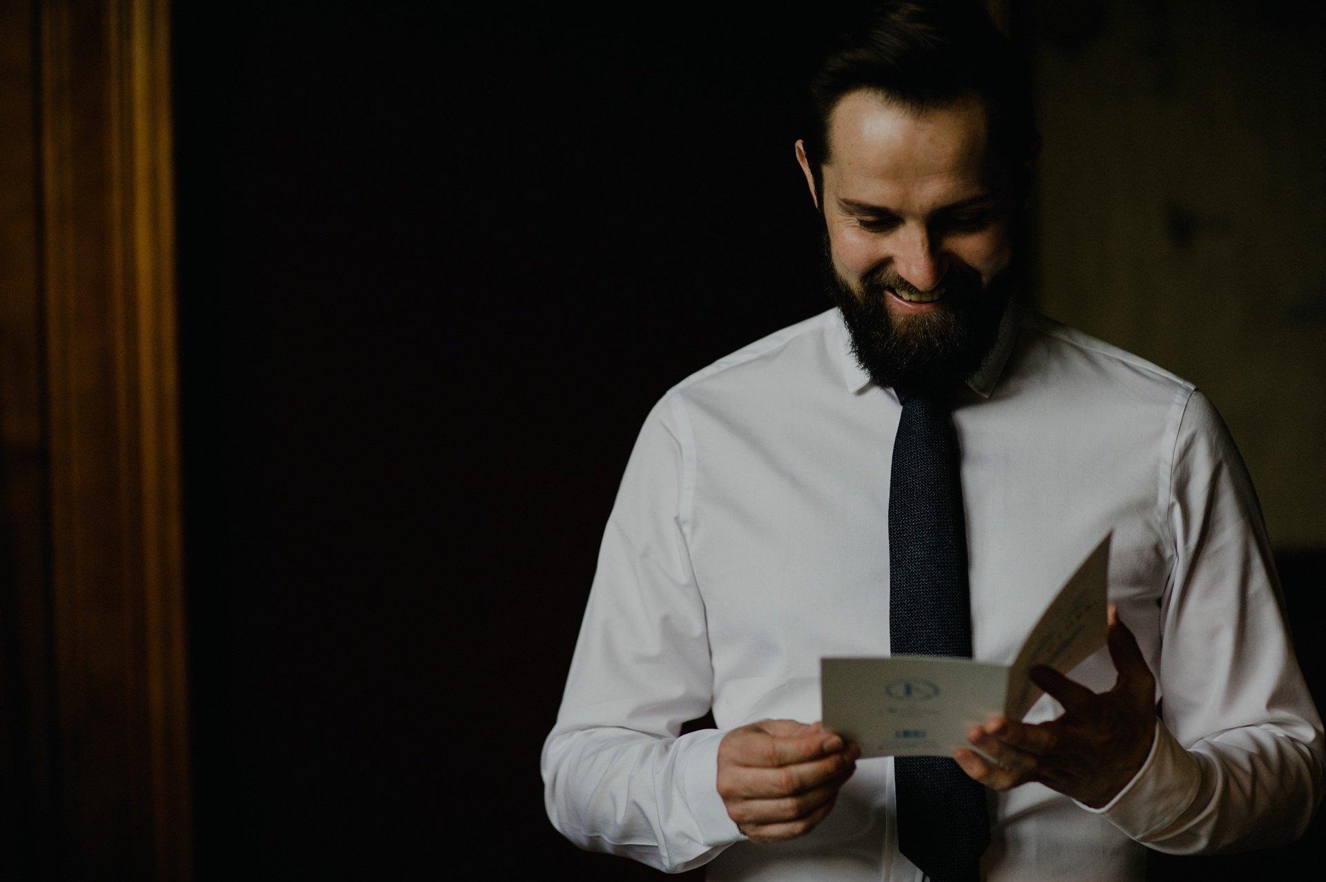 groom reading a card