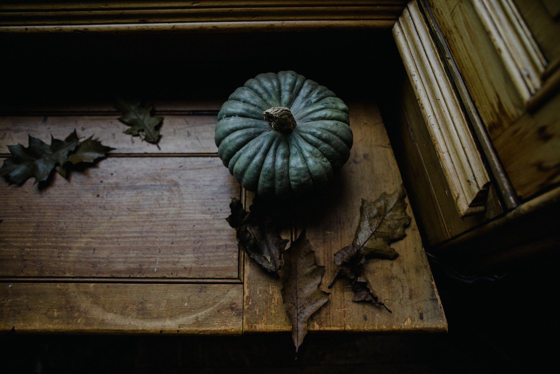 pumpkin squash sitting on window ledge