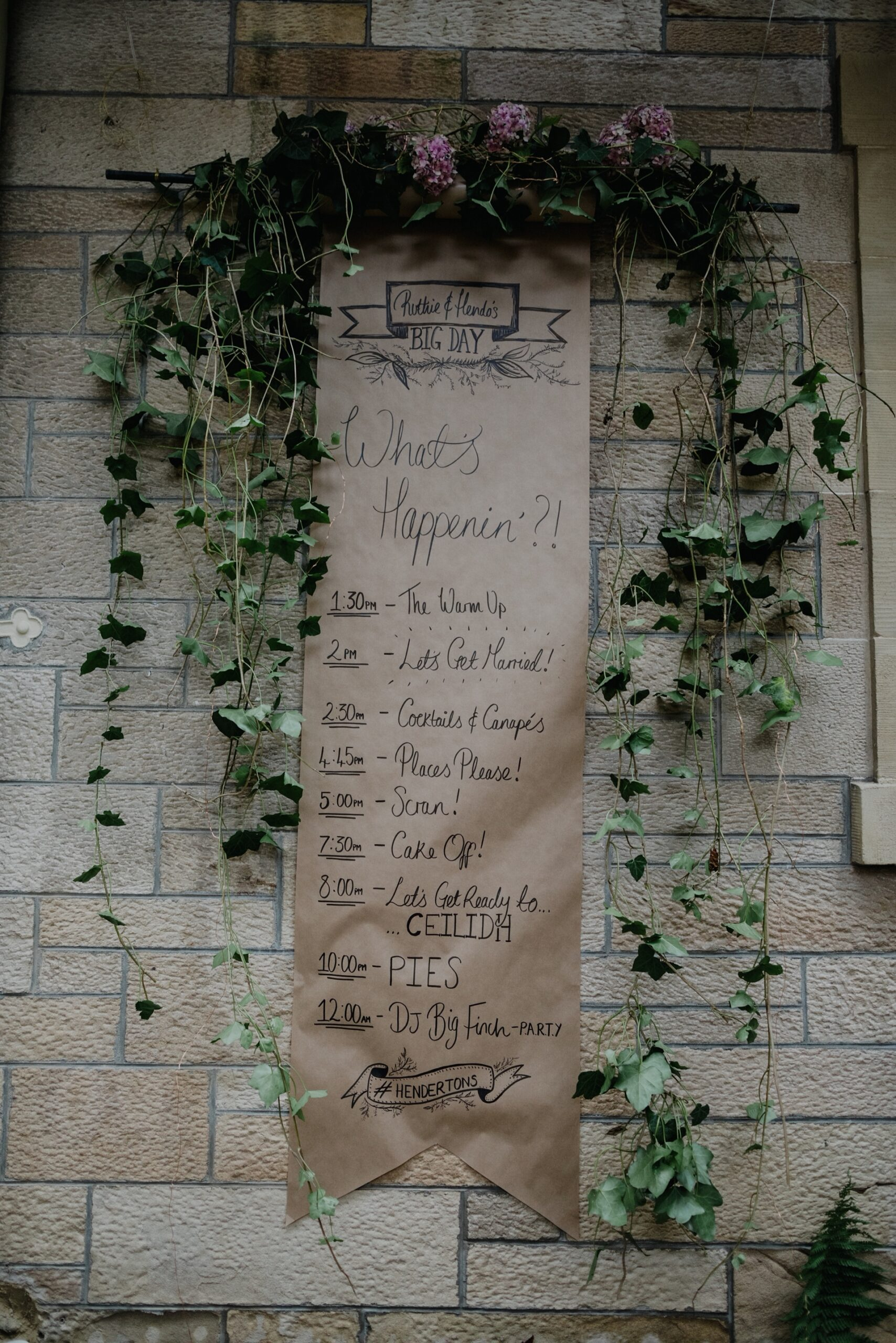 wedding timeline order of the day on brown paper with green foliage