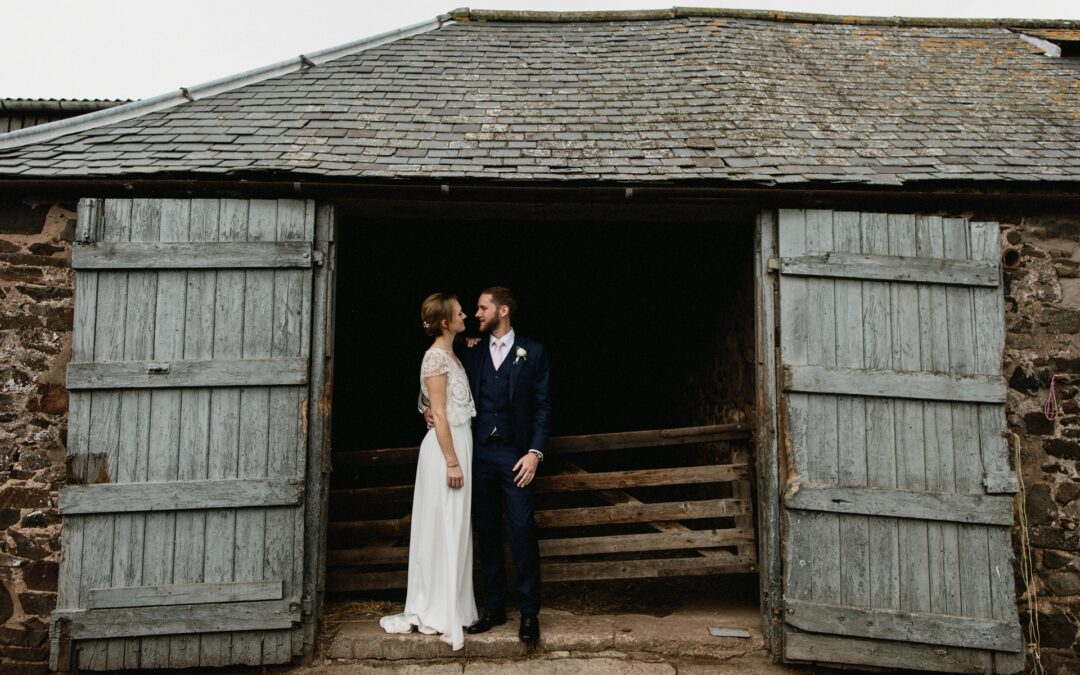 bride and groom pictured in the stables