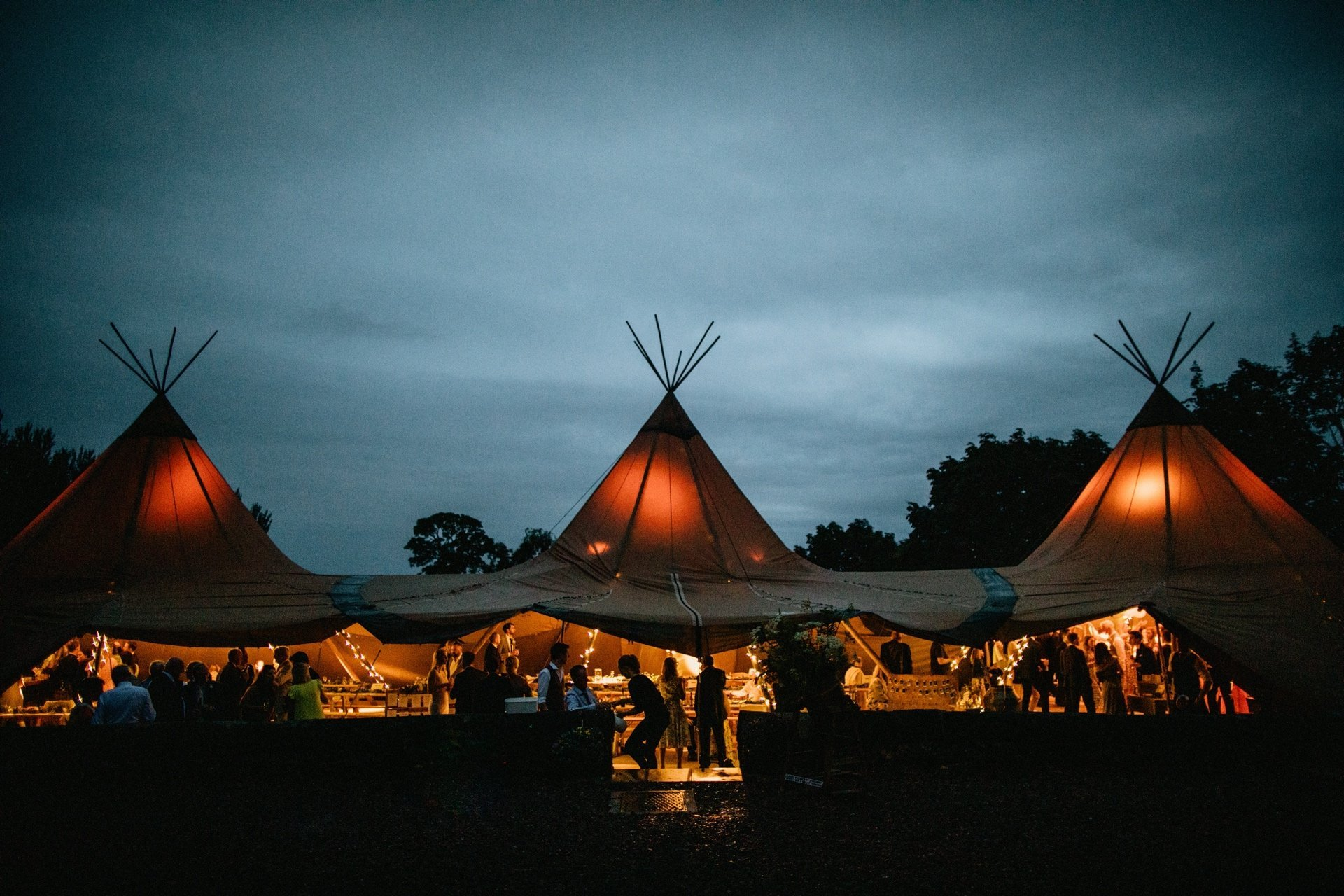 tipis lit up at night